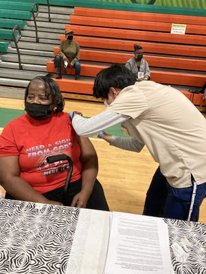 Mary Ann Fyall of Ridgeland receives the Moderna COVID-19 vaccine during a clinic this month at Hardeeville-Ridgeland Middle School.