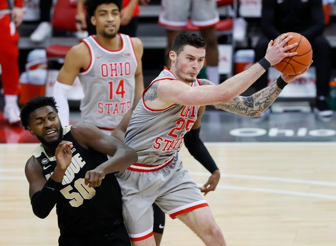In four years at Ohio State, senior forward Kyle Young (25) has forged a strong relationship with coaches and fans who appreciate his willingness to work in the hard areas.