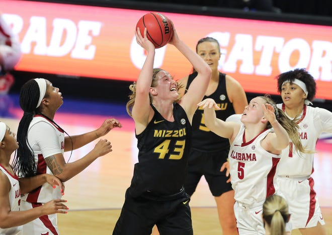 Missouri's Hayley Frank (43) controls the ball as Alabama's Hannah Barber (5) defends during a game Thursday night at Bon Secours Wellness Arena in Greenville, S.C.