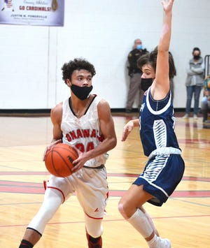 Senior guard Kevin Pearson (left) scored a game-high 33 points to help lead the Onaway varsity boys to a home victory over Central Lake on Thursday.