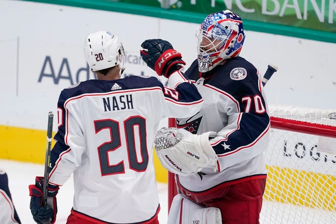 Riley Nash (20) and goaltender Joonas Korpisalo (70) celebrate the Blue Jackets' 3-2 win over the Dallas Stars on Thursday night at American Airlines Center in Dallas.