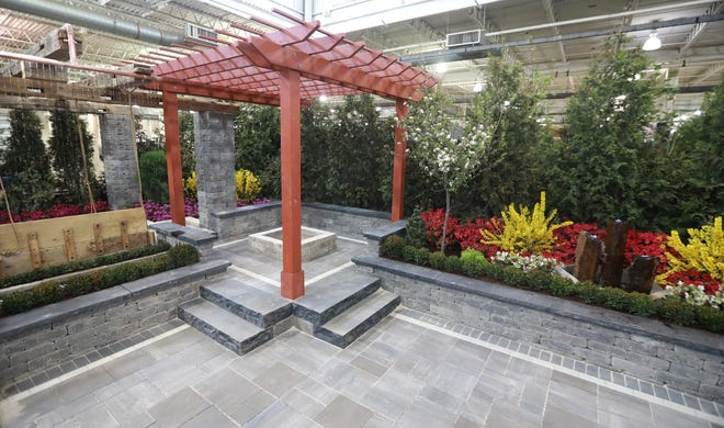 Inside Outside: The Outdoor Rooms Experience by Seely's Landscape Nursery features a large pavilion for entertaining and a hanging bed.