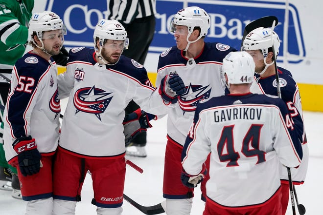 Emil Bemstrom (52), Oliver Bjorkstrand (28), Riley Nash (20), Vladislav Gavrikov (44) and Michael Del Zotto, right, celebrate Bjorkstrand's goal that put the Blue Jackets up 2-0 against the Dallas Stars on Thursday. The Jackets won 3-2 for their second straight victory.