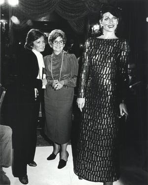 Fashion designer Lea Gottlieb, center, with her daughter Miriam (left) and a model