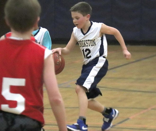 Colton Osborn dribbles up the court during the CYBA Boys' Tournament on March 25, 2019.