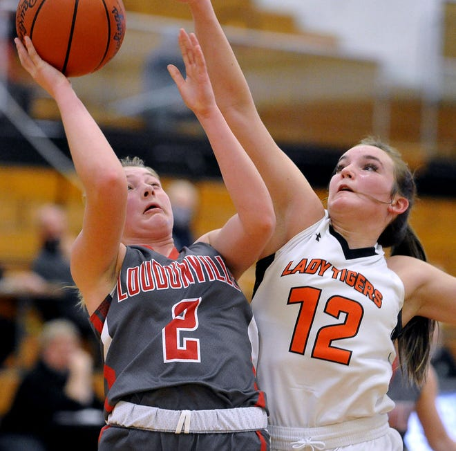Loudonville's Corri Vermilya puts this shot up against Shadyside Gentry Brown.