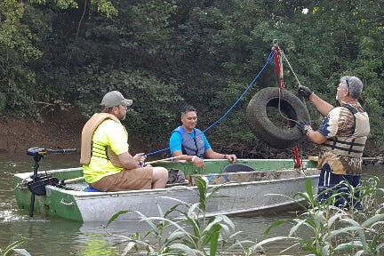 Volunteers assist in the annual cleanup of the Duck River organized by Keep Maury County Beautiful in 2017.