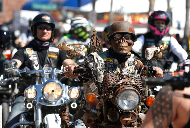 Bikers cruise Daytona Beach's Main Street on Friday, the first day of Bike Week.