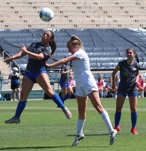 Bartram Trail's Grace Ivey, right, heads a shot during Friday's Class 7A girls' soccer final against Weston Cypress Bay. The sophomore midfielder scored a hat trick as the Bears again won the state title.