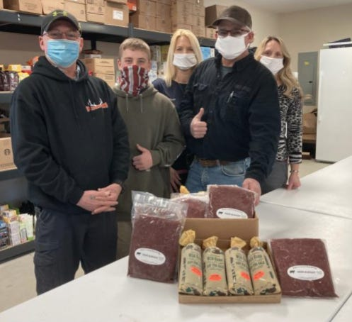 LACKAWAXEN  TWP. - The Lackawaxen Care Cabin volunteers are shown happily accepting venison donations to distribute to their patrons.  From left:  Pike County HSH Coordinator Ron Tussel, Evan Huber, Lynn Mills, Jeff Shook, Michelle Thompson.