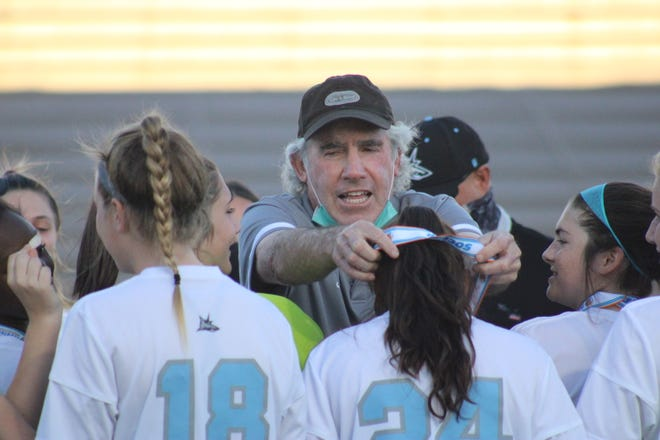 Ponte Vedra High School girls soccer coach Dave Silverberg (center) hands out championship medals after winning the Class 5A title on March 5. Silverberg was named the state's coach of the year Wednesday.