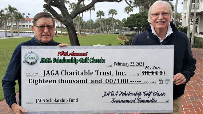 JAGA Scholarship Trust Classic chairman Adair Roberts (left) and Trust vice chairman Michael McKenny (right) display the $20,500 check that will benefit JAGA scholarships.