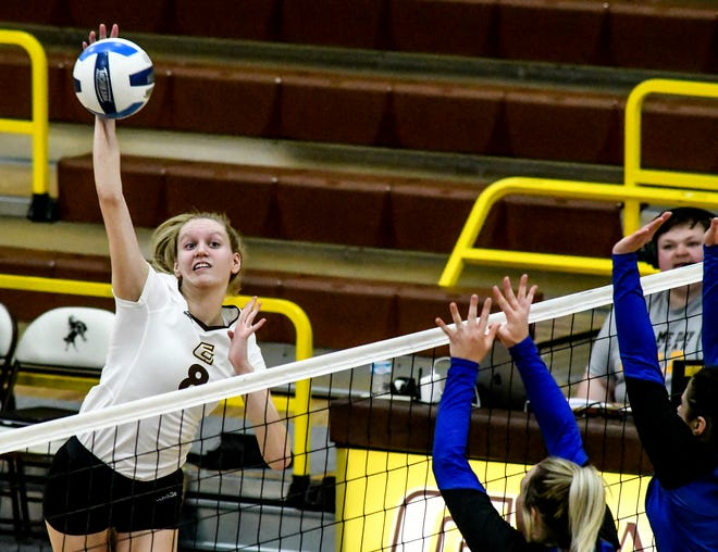 Garden City Community College's Reagan Karlin drives the ball past a pair of Pratt defenders for a kill Thursday during a match at Perryman Athletic Complex.