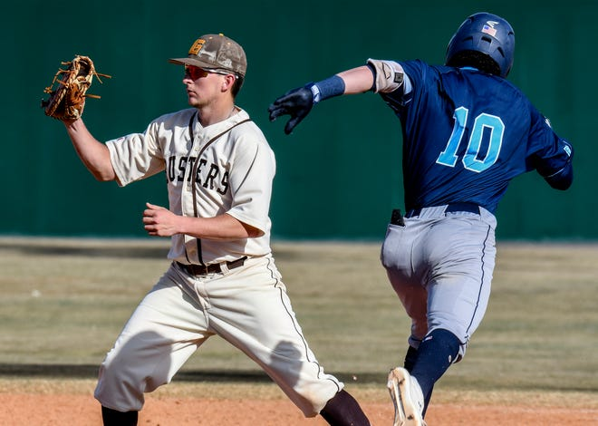 Garden City Comunity College first baseman Tyler Barth, left, squeezes his glove shut around the ball as he takes a throw at first base to get Colby's Brayden Nichols out Feb. 26 at Williams Stadium.