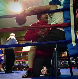 A boxing coach is seen here giving advice to his fighter during the 2017 Golden Gloves tournament inside the Fall River Police Athletic League building.