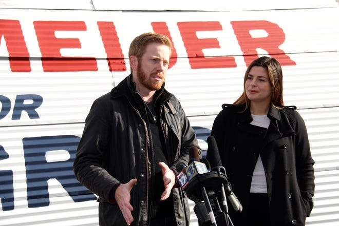 Now-Rep. Peter Meijer, R-Grand Rapids, speaks to reporters alongside his wife, Gabriella, in Grand Rapids, Mich. on Thursday, Nov. 5, 2020.