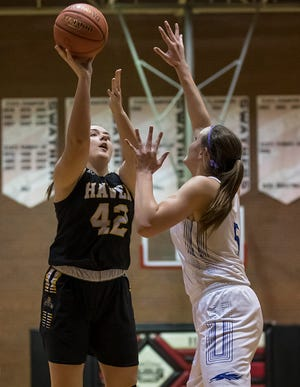 Haven's Maguire Estill (42) shoots over Halstead's Karenna Gerber (5) during their Class 3A Sub-State semifinal game in Hesston Thursday night. Halstead defeated Haven 37-27.