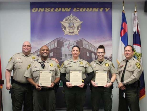 Onslow County Sheriff's Office detention officers recently received their promotion warrant and were pinned in a promotion ceremony. Pictured are Maj. L. Straughn, Cpl. K. Smith; Cpl. N. Borowy; Cpl. K. Parham; Col. C. Thomas.