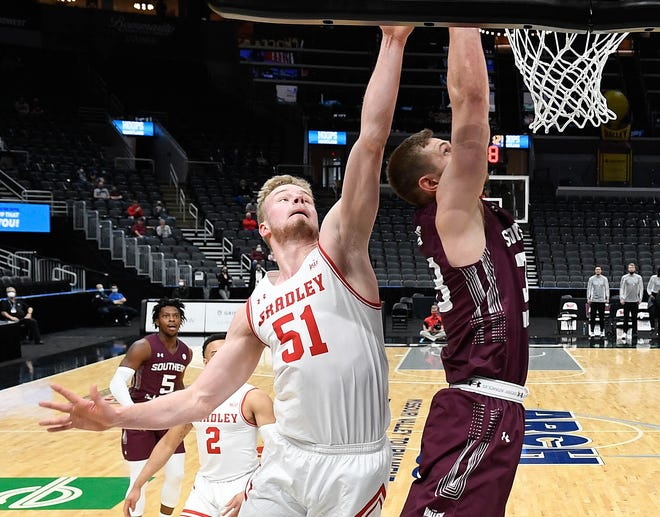 Bradley's Rienk Mast goes up to block a shot during the opening round of the Missouri Valley Conference Men's Basketball Tournament against Southern Illinois. The Braves ended their season with a 73-63 loss at Enterprise Center in St. Louis.