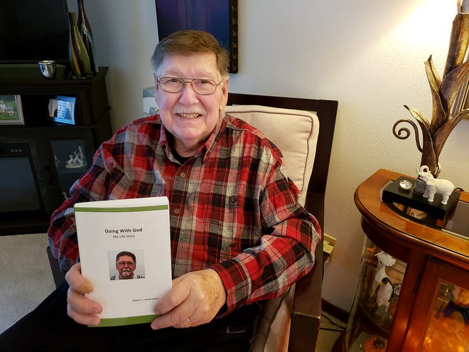 """Bob Hendrickson holds a copy of his latest book """"Going With God: My Life Story"""" on Tuesday, March 2, 2021, at his home in Freeport."""