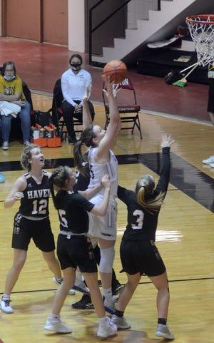 Halstead senior Karenna Gerber draws a quadruple team on a shot during play Thursday against Haven. Gerber scored 12 points in a 37-27 Dragon win.