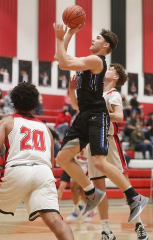 Cuyahoga Valley Christian Academy's Brennan Darr goes to the hoop against Norton in Division II district semifinal game at North High School in Norton on Thursday March 4, 2021.  Norton beat CVCA 75 to 45. [Mike Cardew/Akron Beacon Journal]