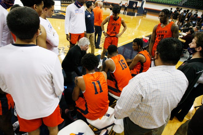 South Plains head coach Steve Green talks to his players on the bench in the first half of a Western Junior College Athletic Conference game March 4 against Odessa College in the Texas Dome.