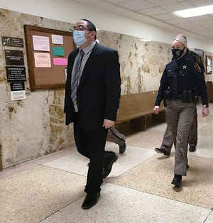 Joe Gregory Salinas is escorted to the 364th District Court where he faced charges on two counts of aggravated sexual assault of a child.