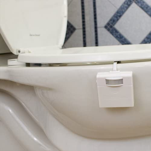 The IllumiBowl Toilet Night Light consists of a motion detector that hangs on the outside of the toilet bowl, connected by a flexible wire to an LED light that hangs inside the bowl.