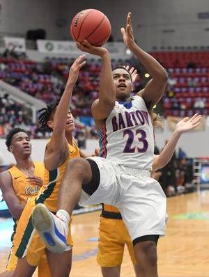 Bartow's Kjei Parker (23) shoots against Forest during their Class 6A semifinal in the Florida High School State Championships at the RP Funding Center in Lakeland.