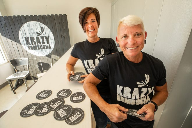 Wendy Johnson , left and A.J. Jackson are opening Krazy Kombucha in Dixieland on South Florida Avenue. Johnson bought the darling of the Lakeland Saturday downtown farmer's market from its previous owner.