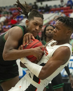 Choctawhatchee's Amarion Pettis (22) and Leesburg's Camerin James (2) battle for a rebound under the basket during the second half of their FHSAA Boys 5A semifinal game at The RP Funding Center in Lakeland Thursday.