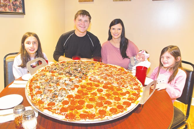 "The 30"" Big Ry's pizza feeds the whole family. It can be made to order but is pictured made with the Meatlovers; Ry's Special; pepperoni; and a combination of pepperoni, sausage, black olive and mushroom."