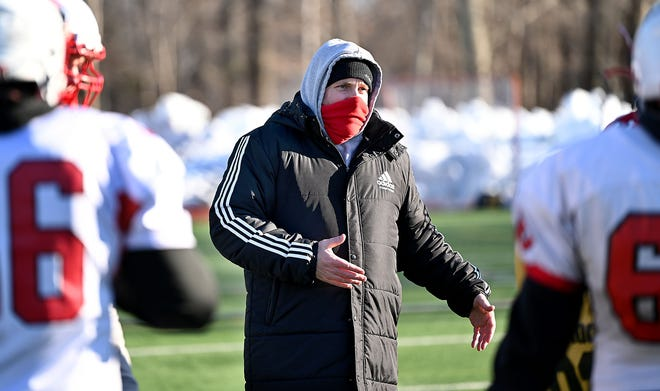 Milford High football's new head coach Dale Olson directs practice on March 5, 2021.
