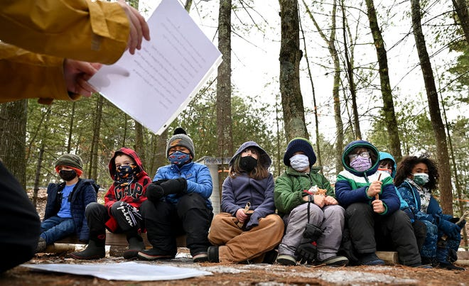 First- and second-graders listen to learning coach Jill Kelley during a recent outdoor class at the Fitzgerald Community School, a private preK-5 elementary school in Northborough that puts an emphasis on outdoor learning. Students spend a portion of each school day playing or learning in nature, no matter what the weather, and have done so since the school opened in 2014.