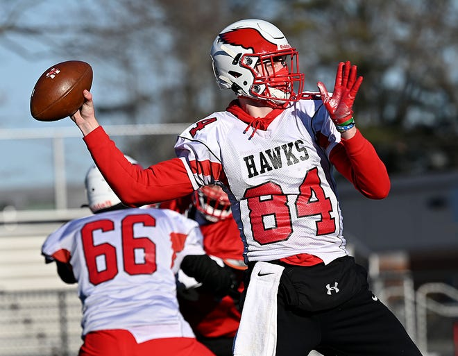 Milford quarterback Brady Olson throws a pass during practice on March 5, 2021.