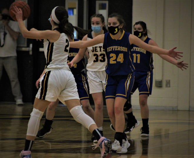 Jefferson's Kirsten Vanisacker (24) defends against Airport's Mara Szuper on Thursday, March 4, 2021 at Airport High School.