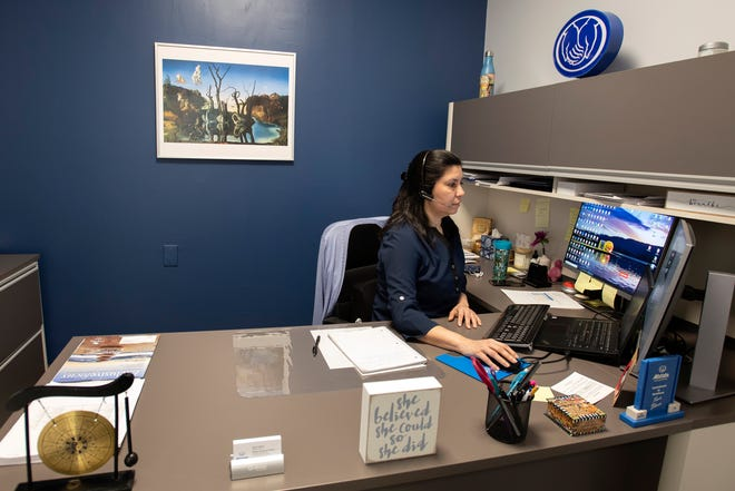 Tania Blanco prepares for a virtual session with a client in her Allstate Insurance office on Worcester Road in Framingham, March 5, 2021.