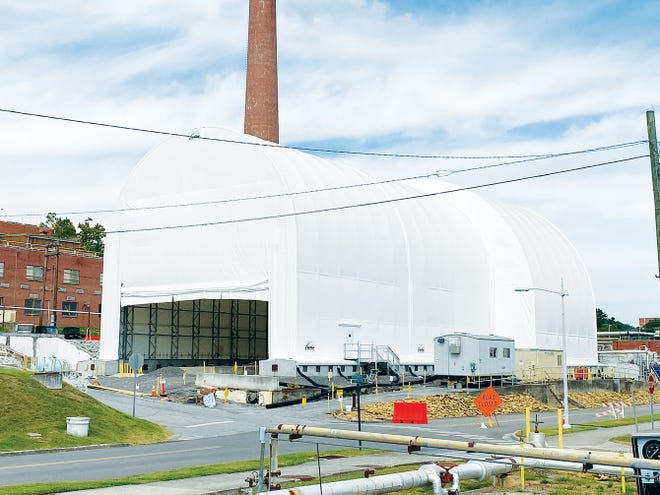 UCOR constructed a six-story protective cover over the hot cells at the former Radioisotope Development Lab to ensure nearby research facilities were not impacted during the hot cell demolition project.