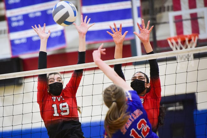 VVS players LeeAnne Lowery (19) and Sadie Riggs attempt to block a kill from New Hartford player Makenzie DesMarais (12) on Thursday at New Hartford High School. VVS won 3-2.