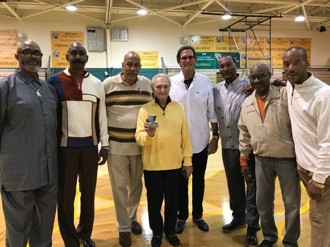 Head coach Joe Ceravola (center) and assistant coach Willie Gibson (second from right) with members of the 1978 Palm Beach Junior College state championship basketball team at a reunion in January 2019.