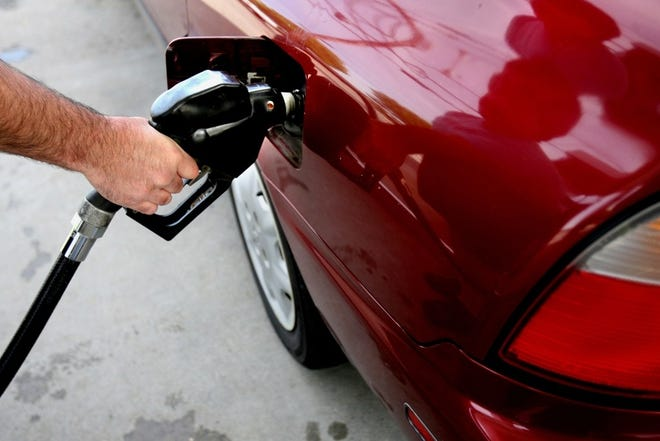 Rhode Island is moving ahead with plans to join a regional initiative that aims to cut vehicle emissions through a fee on gasoline and diesel distributors, with proceeds invested in electric vehicles, mass transit and other cleaner transportation options.