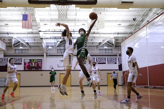 Hendricken's Azmar Abdullah goes hard to the basket midway through the third quarter during Hendricken's eventual 84-78 overtime win over rival La Salle in Thursday's Division I semifinal game.