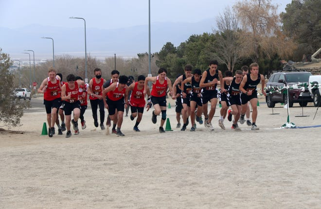 The Burroughs High School and Oak Hills High School boys cross country teams compete against each other Wednesday afternoon.