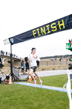 Oregon's Jackson Mestler finishes in third place at the Pac-12 Cross Country Championship meet Friday.