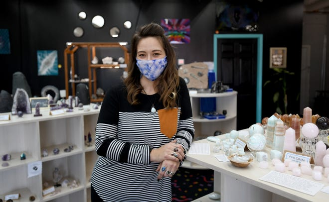 Amber Johnson, owner of Oily Mama's Creations, sells items and jewelry made from crystals at her shop. She started the business at home selling essential oils, and in December opened a storefront location on Martindale Road in Plain Township.