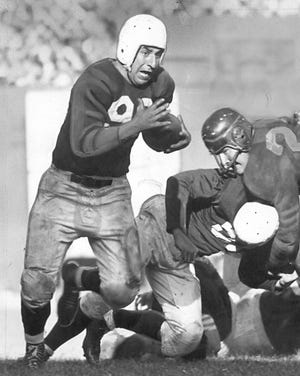 Marshall Goldberg gains 7 yards against the Chicago Bears during the third quarter of the Cards 31-7 win, Oct. 6, 1947.