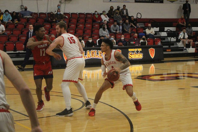 Flagler's Jaizec Lottie hitting a step back move against USC Aiken in the Peach Belt Conference Tournament. Photo taken on March 4, 2021.