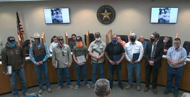 Seven City of Stephenville Utilities Department employees were presented Valor Awards during Tuesday's city council meeting for their above-and-beyond efforts to repair water line breaks during Winter Storm Uri. The awards were presented by City Manager Allen Barnes and Mayor Doug Svien, pictured at right.