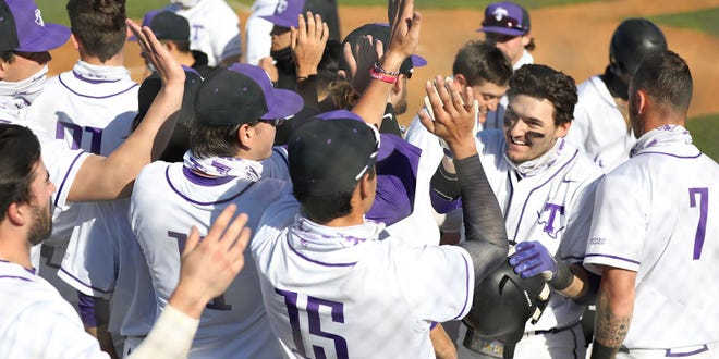 Colby Seltzer is congratulated for his home run during this week's series against Arkansas-Pine Bluff. The Texans run-ruled both games and racked up 39 runs.